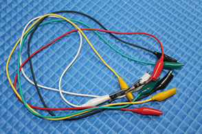 This picture shows jumper wires terminated with alligator clips.  These are useful for hands free connecting to off board components.