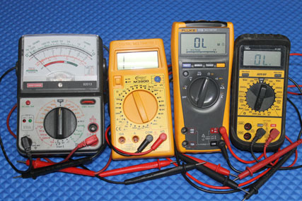 This picture shows four multi-meters.  An analog meter from Craftsman, a Knight DMM, Fluke 77 series IV, and an Ideal 61-360 DMM.